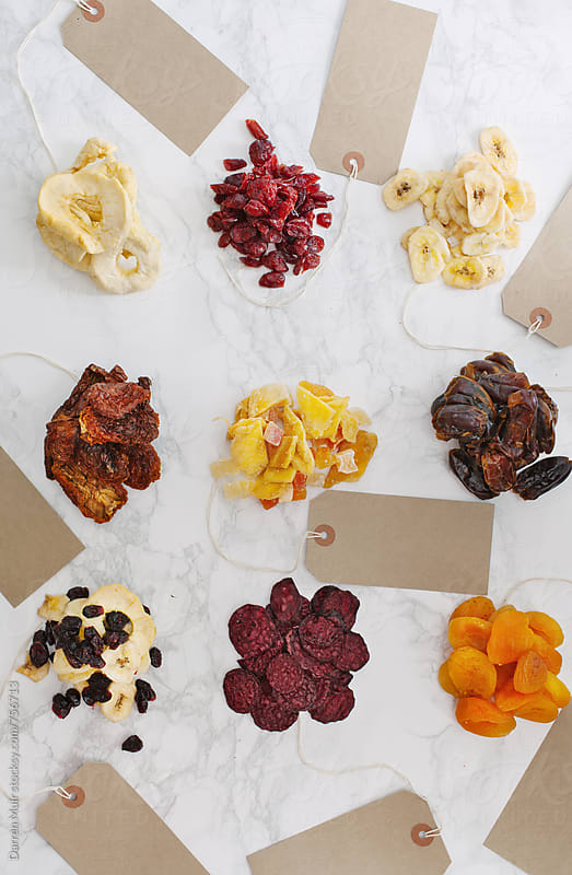 Dried fruit and vegetables on white marble background. by Darren Muir for Stocksy United