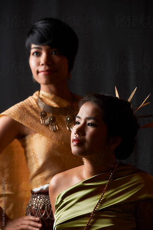 Two Women In Traditional Style Thai And Isaan Dresses by Adrian P Young for Stocksy United