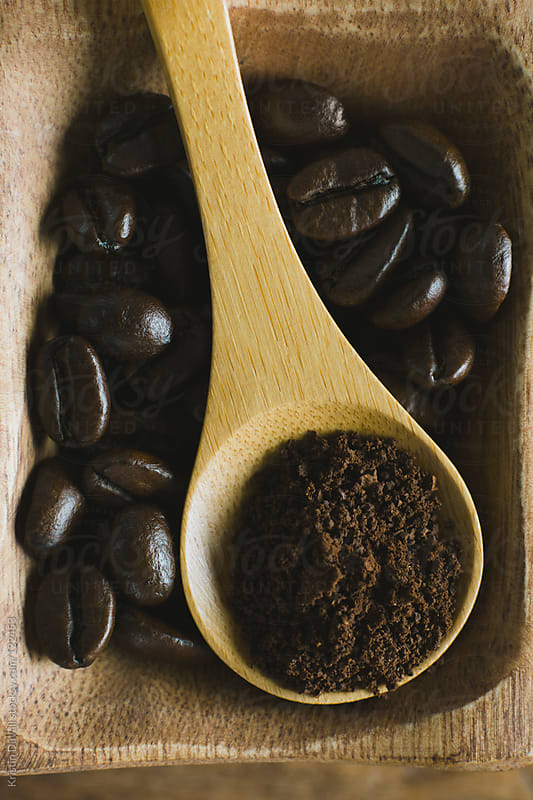 Whole and ground roasted coffee beans by Kristin Duvall for Stocksy United