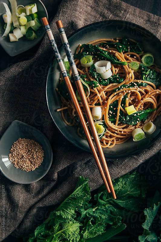 Soba noodles with turnip tops and sesame seeds by Nataša Mandić for Stocksy United