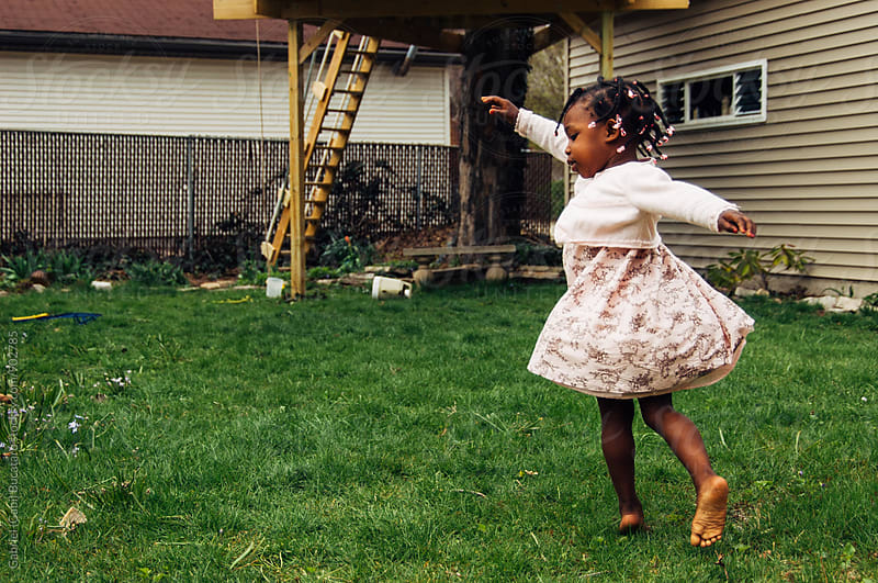 African American girl twirling by Gabriel (Gabi) Bucataru for Stocksy United