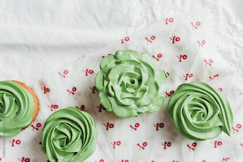Green cupcakes by Tatjana Zlatkovic for Stocksy United