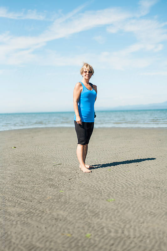 Woman Enjoying Sunshine At The Beach by Nick Walter for Stocksy United