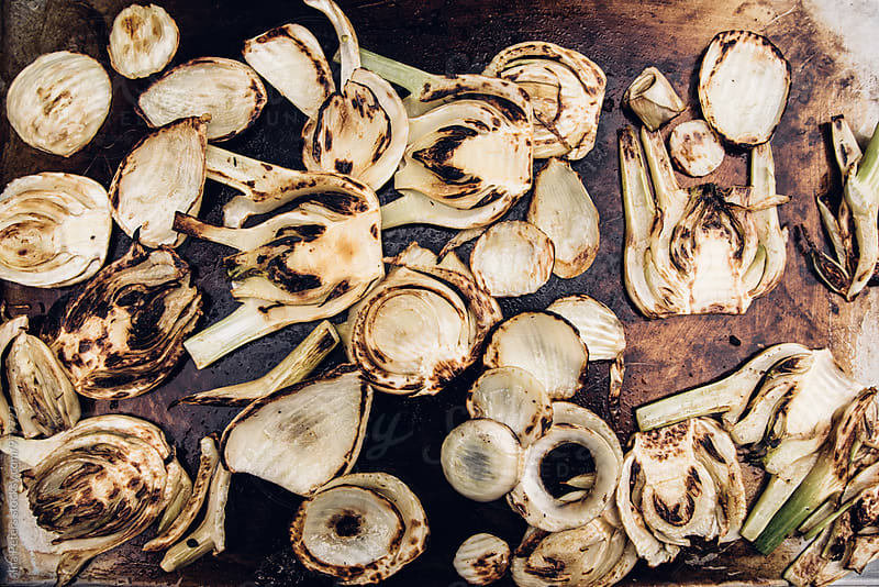 Food: Grilling fennel on a plancha by Ina Peters for Stocksy United