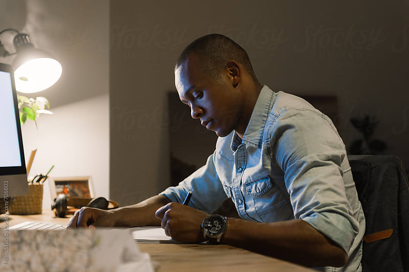 African man at office by Milles Studio for Stocksy United