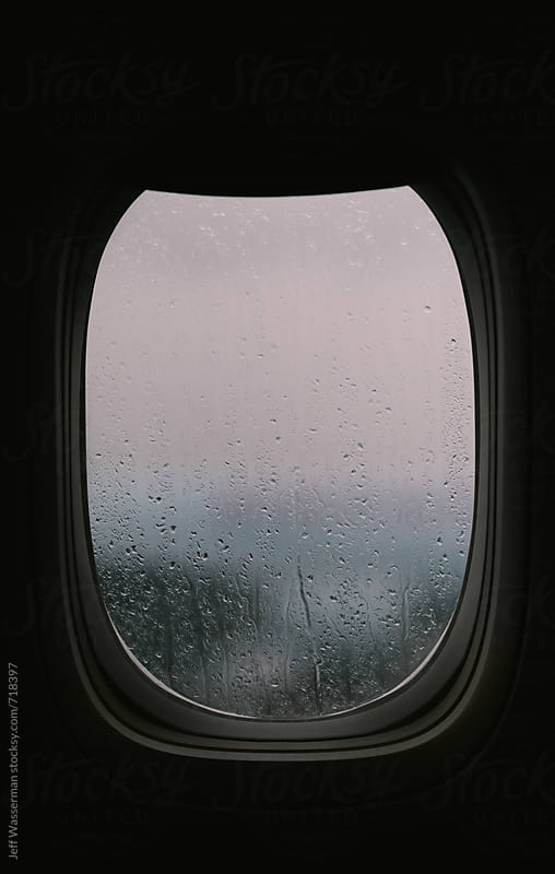 Rainy Plane Window by Jeff Wasserman for Stocksy United