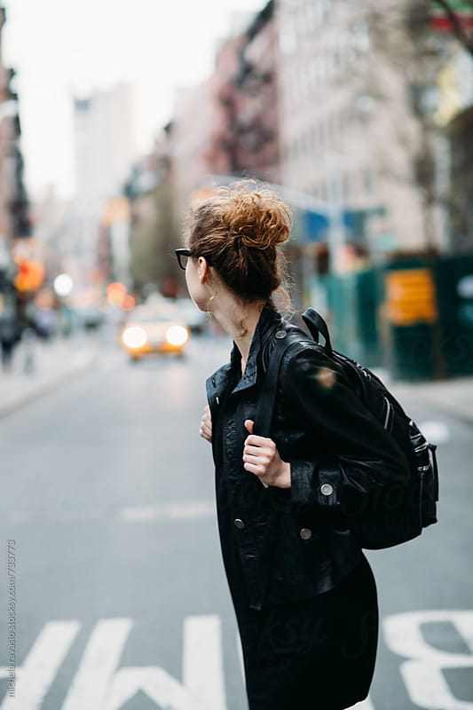 Young woman dressed in black leather waiting for the taxi by michela ravasio for Stocksy United