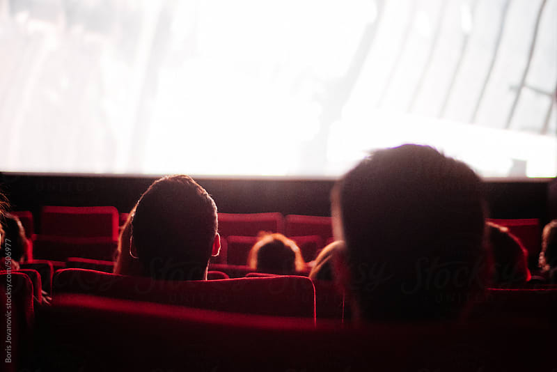 People watching a movie in cinema by Boris Jovanovic for Stocksy United
