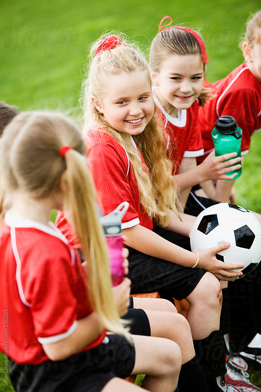 Soccer: Girls Talking While on the Bench by Sean Locke for Stocksy United