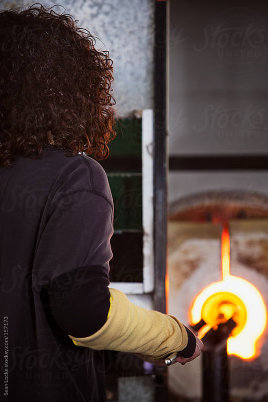 Glass: Artist Puts Glass Back Into Furnace To Heat by Sean Locke for Stocksy United