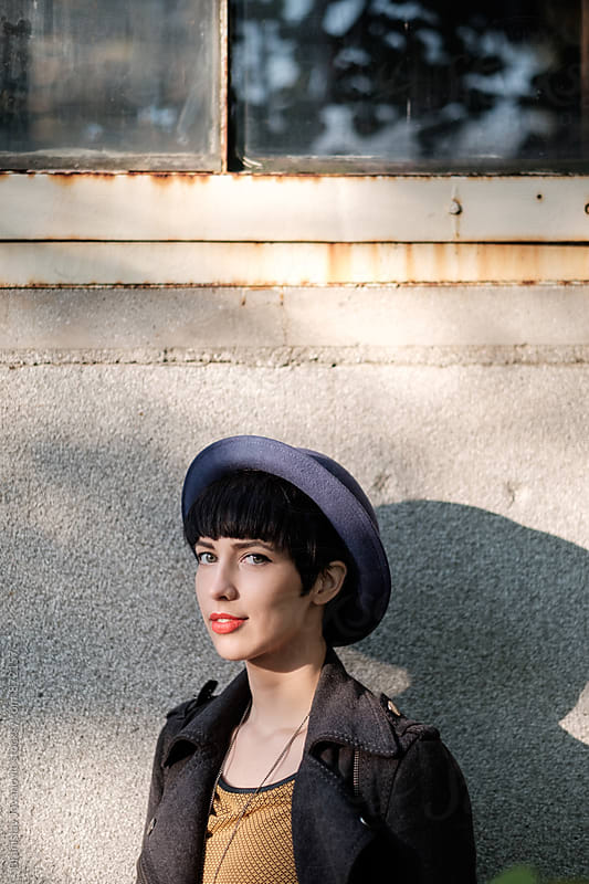 Portrait of a Beautiful Young Woman with Blue Hat by Branislav Jovanović for Stocksy United