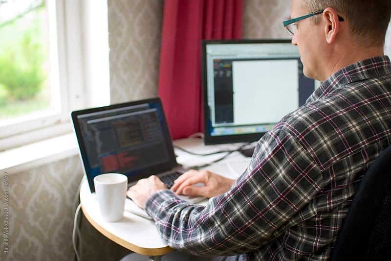 Developer working at home by Harald Walker for Stocksy United