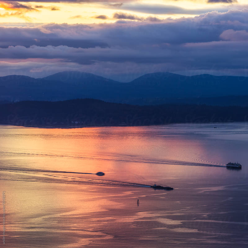 ocean in sunset, Seattle, WA by yuanyuan xie for Stocksy United