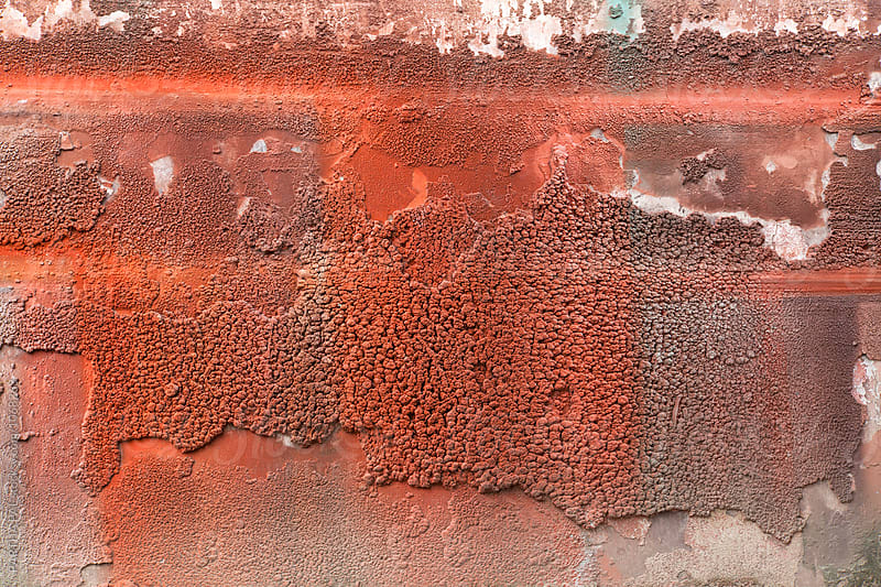 Spray painting with red color on the wall by PARTHA PAL for Stocksy United