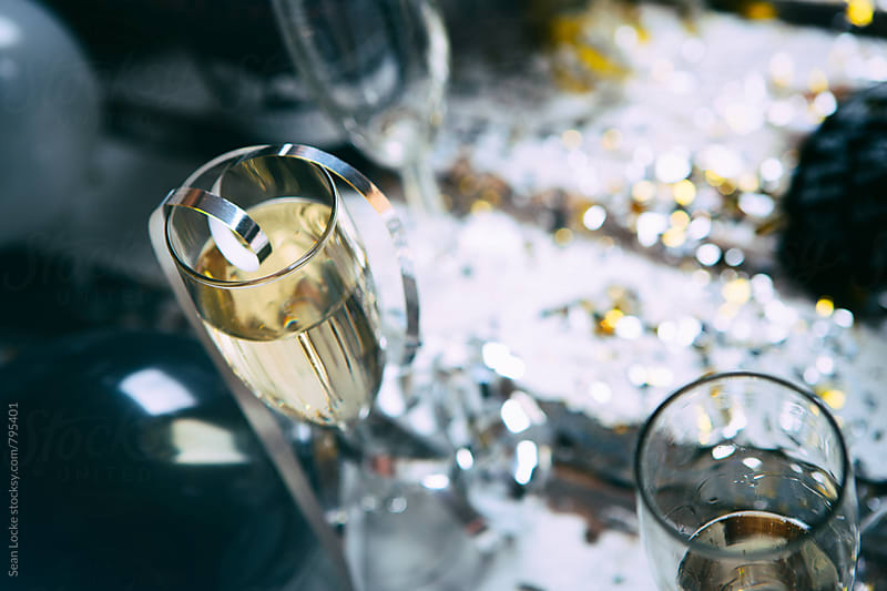 NYE: Silver Ribbon Sits On Top Of Champagne Flute by Sean Locke for Stocksy United