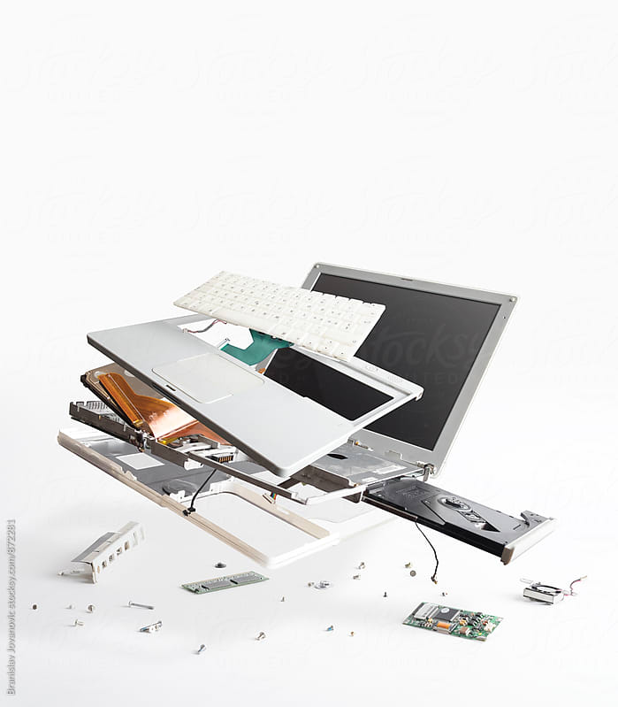 Disassembled White Laptop on the White Background by Branislav Jovanovic for Stocksy United