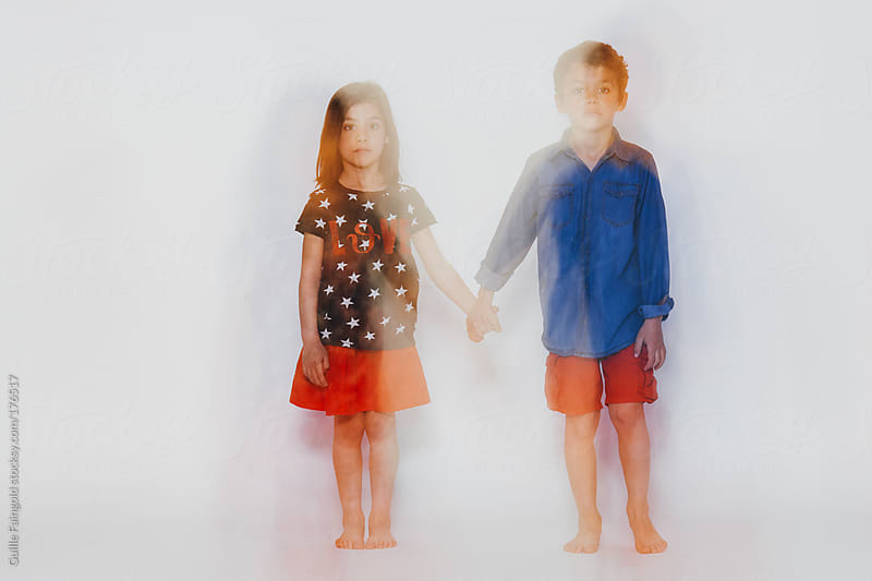Children holding hands.  by Guille Faingold for Stocksy United