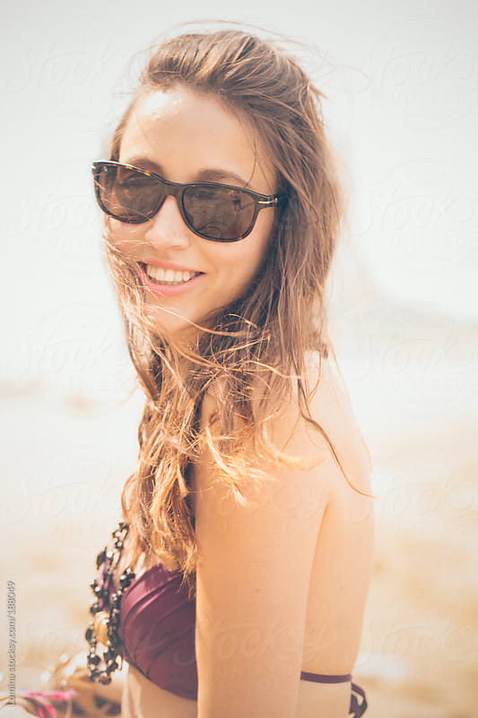 Smiling Woman on the Beach by Lumina for Stocksy United