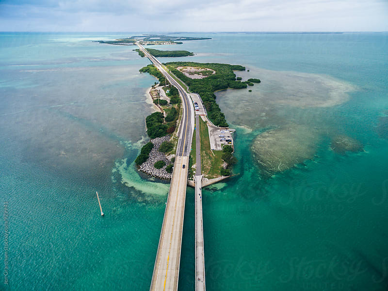 Boat traveling under the Seven Mile Bridge, Florida Keys, USA by Jen Grantham for Stocksy United