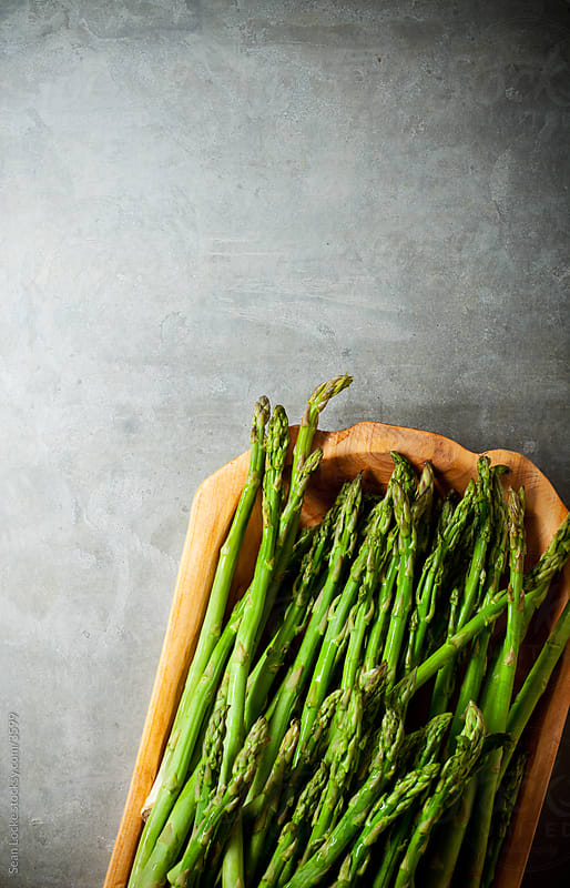 Food: Fresh Asparagus on a Metal Background by Sean Locke for Stocksy United