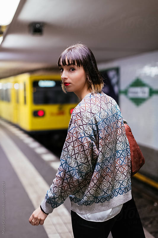 Woman using subway train in Berlin. Germany. by Mauro Grigollo for Stocksy United