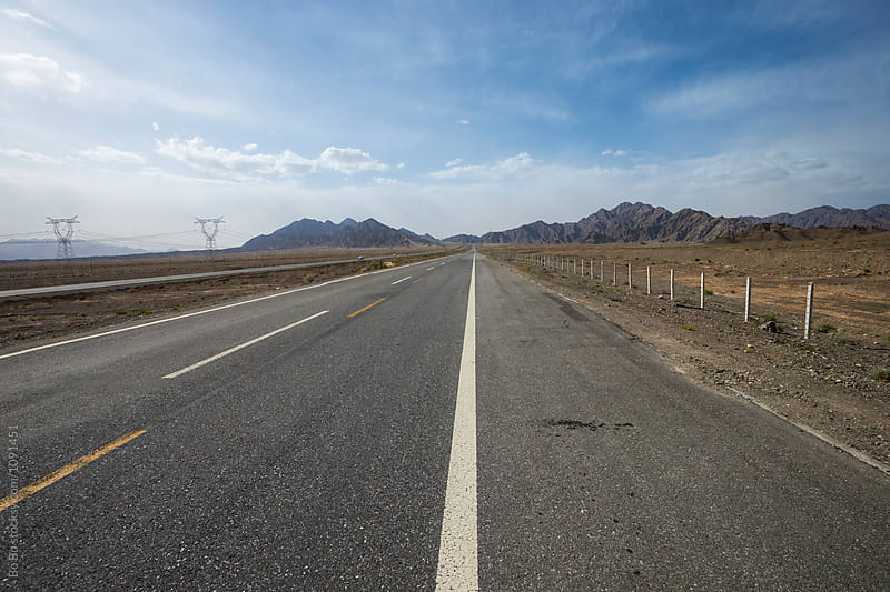 straight road in gobi desert by Bo Bo for Stocksy United