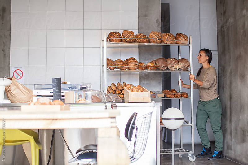 Young Woman Working in a Bakery by Mosuno for Stocksy United