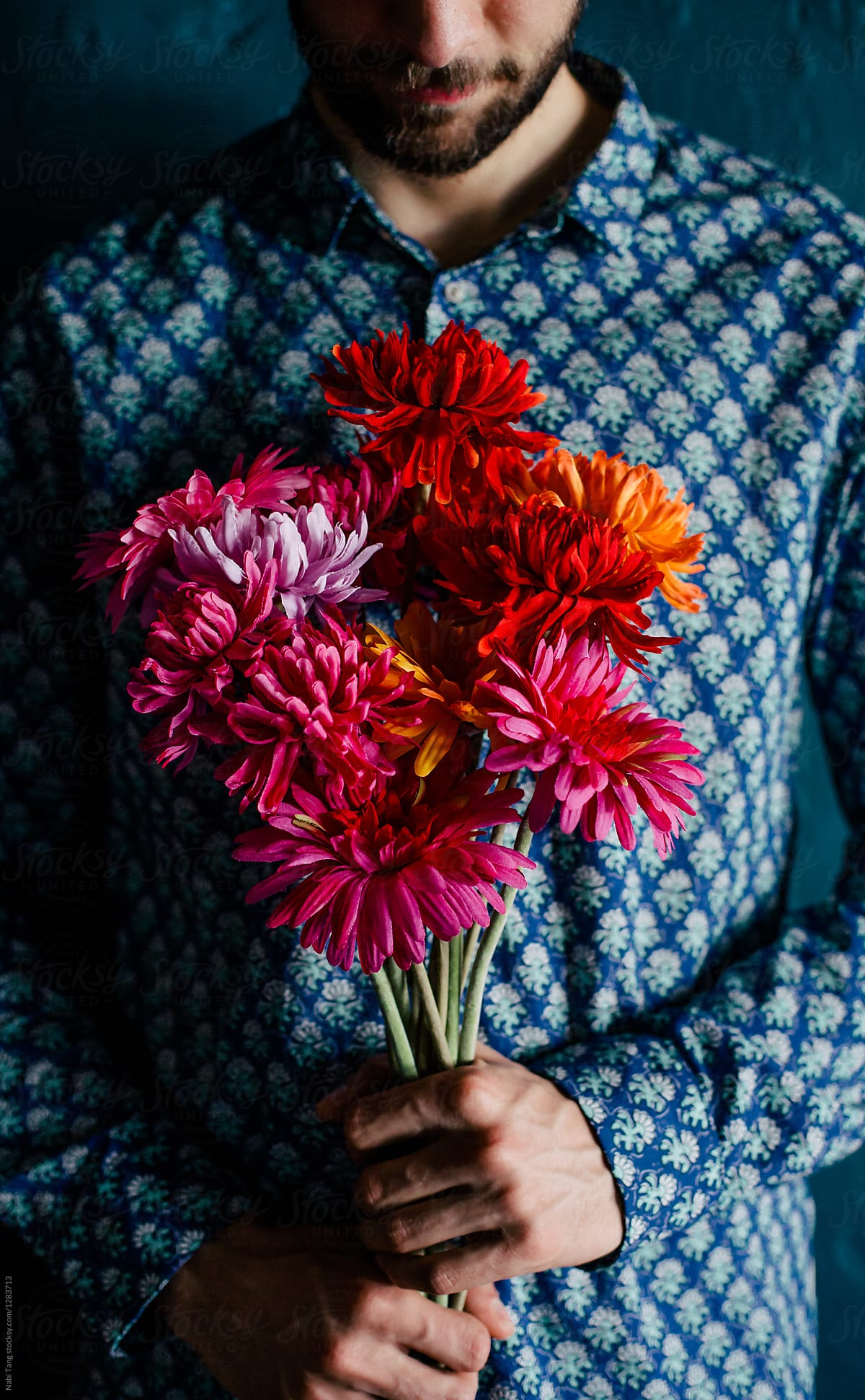Man Holding Colorful Flower Bouquet Stocksy United