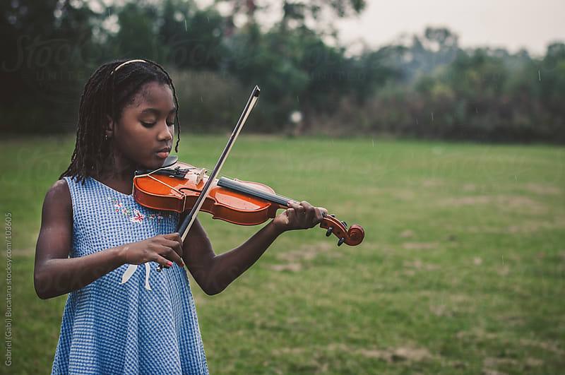 Girl playing violin by Gabriel (Gabi) Bucataru for Stocksy United