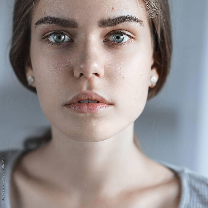 portrait of a beautiful young girl with perfect skin by Andrei Aleshyn for Stocksy United