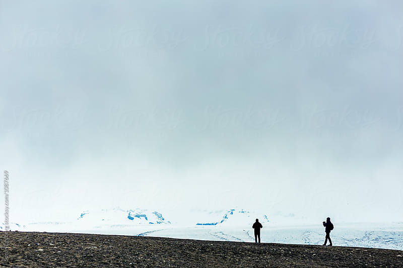 Two hikers enjoying a glacier landscape in Iceland by Søren Egeberg Photography for Stocksy United