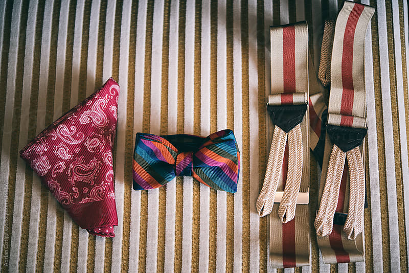 Suspenders, bow tie and handkerchief by Adrian Cotiga for Stocksy United