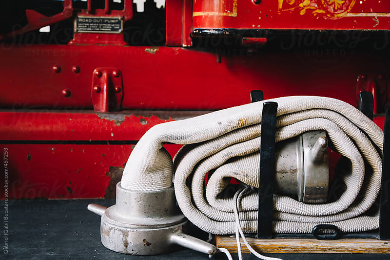 Water hose on an old fire engine by Gabriel (Gabi) Bucataru for Stocksy United