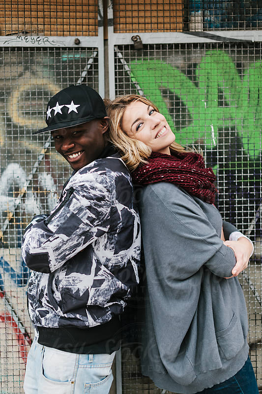 Young Multi-Ethnic Couple in the Street by VICTOR TORRES for Stocksy United