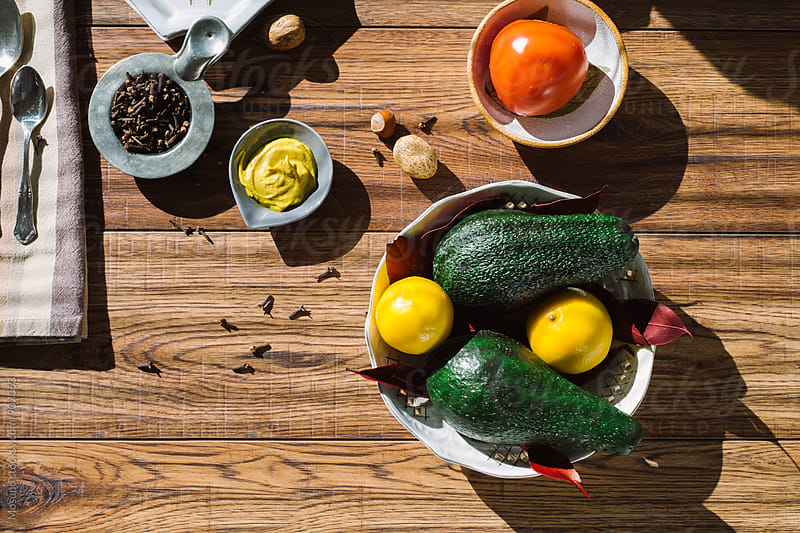 Avocados, Tomatoes and Spices on a Wooden Table by Mosuno for Stocksy United