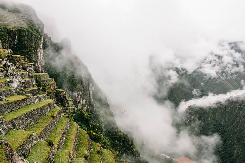 Machu Picchu Inca ancient ruins on a cloudy valley by Alejandro Moreno de Carlos for Stocksy United