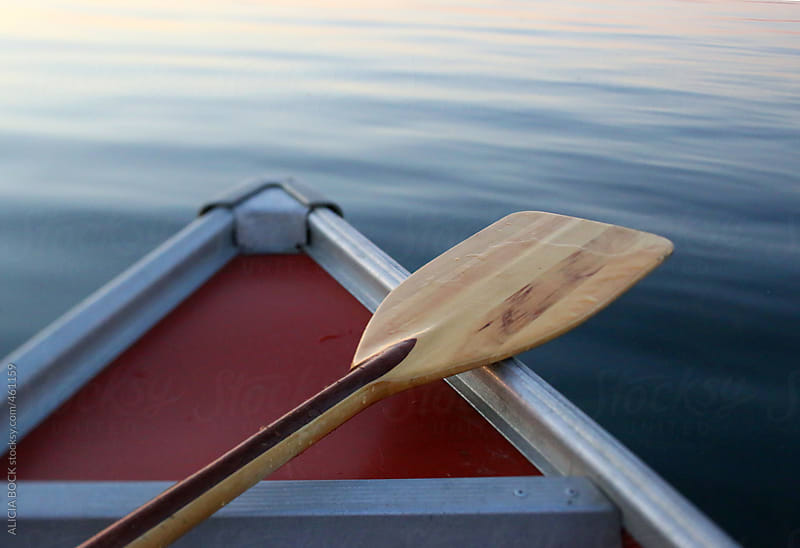 A Canoe Paddle Resting On A Canoe Bow by ALICIA BOCK for Stocksy United