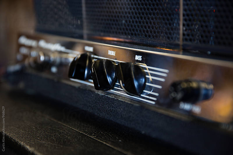 Knobs on a guitar amplifier by Curtis Kim for Stocksy United
