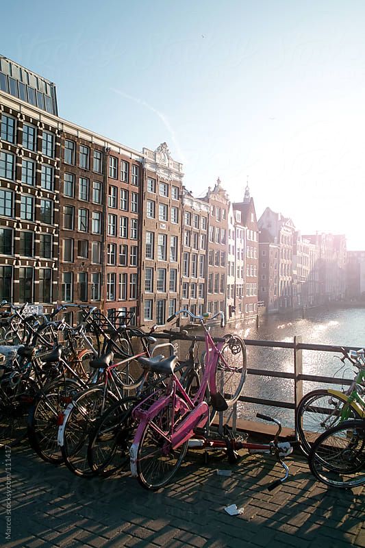 Bicycles on a bridge in Amsterdam by Marcel for Stocksy United