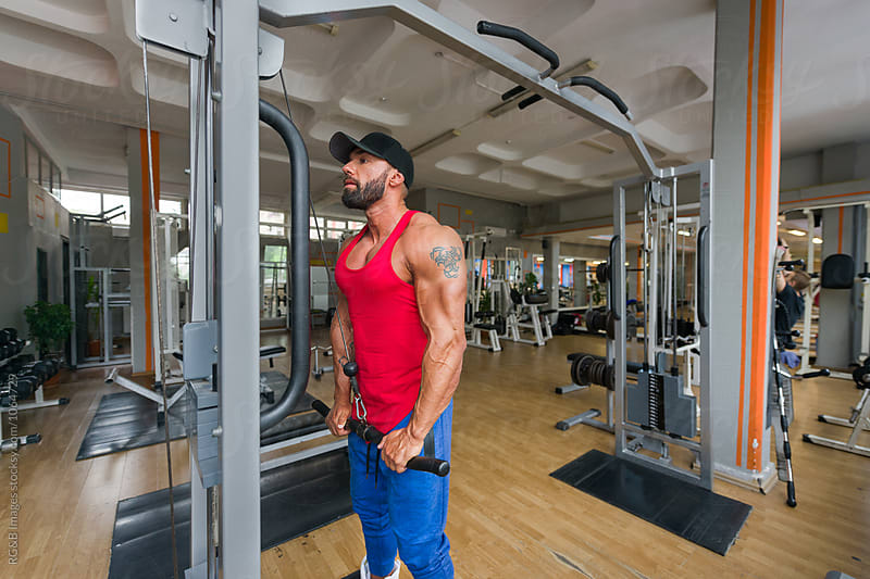 Muscular man traing at the gym by RG&B Images for Stocksy United