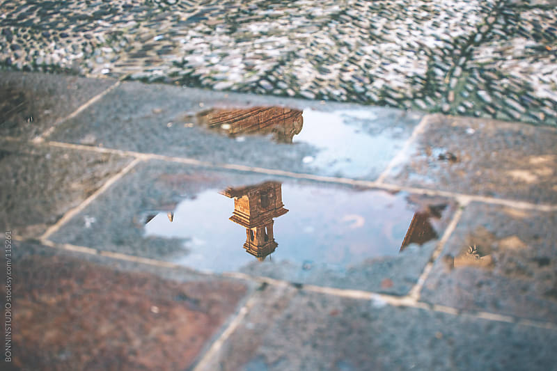 Reflection in a puddle of the cathedral. Gernika, Spain. by BONNINSTUDIO for Stocksy United