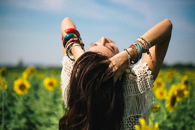 Woman in the Sunflower Field by Marija Savic for Stocksy United