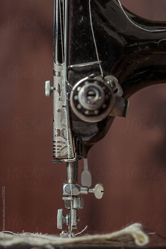 Antique 1950's Sewing Machine against Wood Background by suzanne clements for Stocksy United