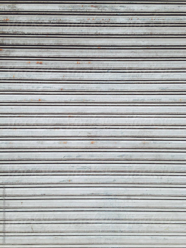 Background of closed shutter doors. by Shikhar Bhattarai for Stocksy United