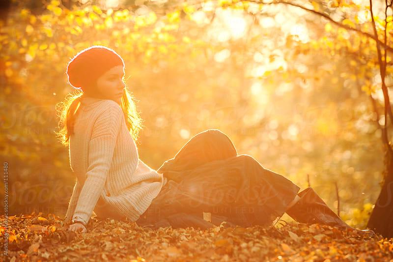 Woman in autumn sunset by Aleksandra Kovac for Stocksy United