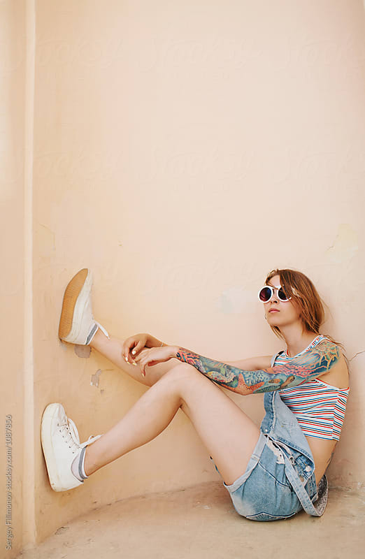 beautiful fashionable tattooed girl with a simple background by Sergey Filimonov for Stocksy United