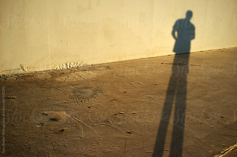 Shadow of a Man in Evening Light by Gary Radler Photography for Stocksy United