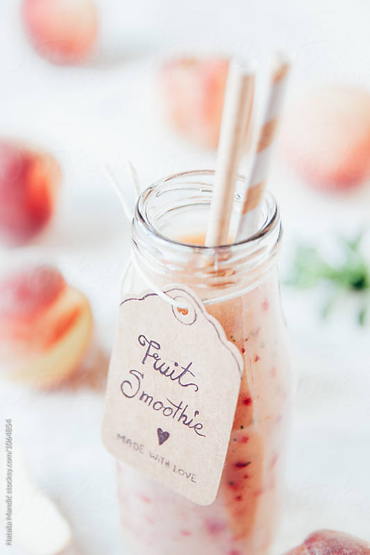 Fresh peach smoothie by Nataša Mandić for Stocksy United