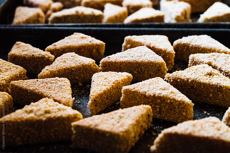 Homemade tofu nuggets on a sheet pan by J Danielle Wehunt for Stocksy United