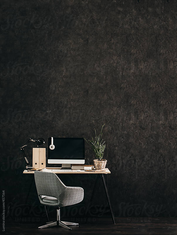 Modern Business Desk Against a Black Wall by Lumina for Stocksy United